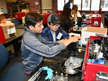 students learning about small engine