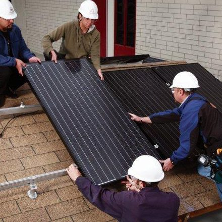 students installing solar panels