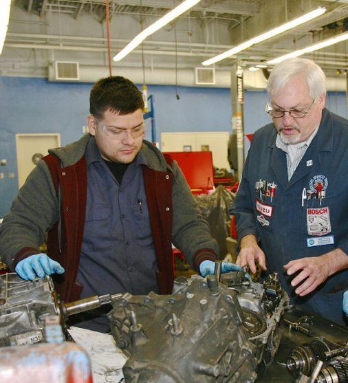 automotive students and a teacher